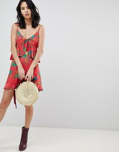 Read more about Honey punch mini skirt with ruffle detail in tropical print co-ord - red