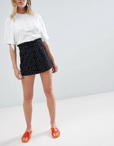 Read more about Monki polka dot jersey shorts - black