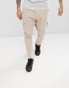 Read more about Bershka frayed hem cargo trousers in beige - beige