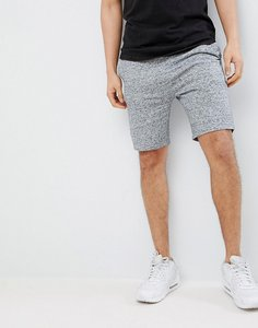 Read more about Asos design skinny shorts in navy interest fabric with contrast navy waistband - navy