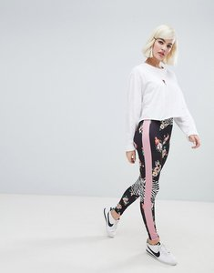 Read more about Asos design leggings in floral print with mixed print panels - multi
