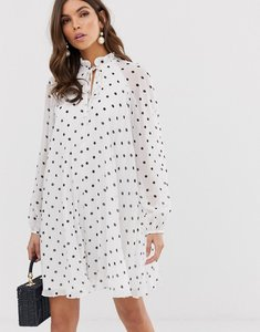 Read more about Asos design pleated trapeze mini dress with tie neck in mono spot print