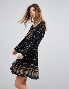 Read more about Free people coryn printed skater dress - black combo