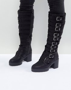 Read more about Asos caution buckle heeled knee high boots - black