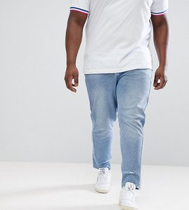 Read more about Asos design plus skinny twisted seam jeans in light wash blue with abrasions - light wash blue