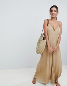 Read more about Asos design deep v strap back jumpsuit - light khaki
