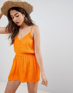 Read more about Asos design playsuit in crinkle with button front - orange