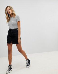 Read more about Missguided raw hem denim mini skirt - black