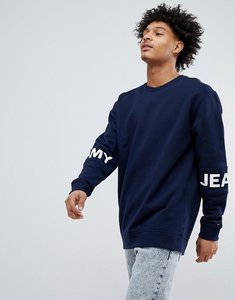 Read more about Tommy jeans essential band sleeve logo crewneck sweatshirt in navy - black iris