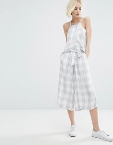 Read more about Native youth awkward length trousers with tie waist in large gingham co-ord - grey