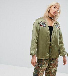 Read more about Milk it vintage festival satin jacket with patches faux fur lining - khaki