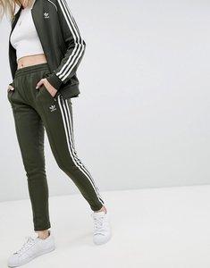 Read more about Adidas originals three stripe track pants in khaki - night cargo