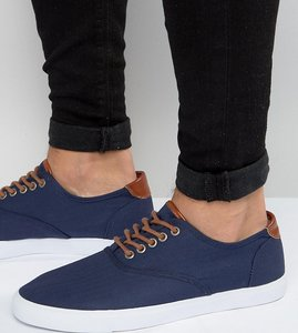 Read more about Asos wide fit lace up plimsolls in navy with tan trims - navy