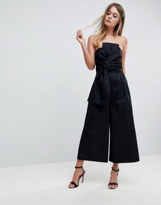 Read more about Asos jumpsuit in bonded lace with knot front and drape detail - navy black
