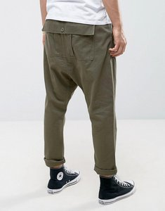 Read more about Asos drop crotch trousers with back pouch pocket in khaki - khaki