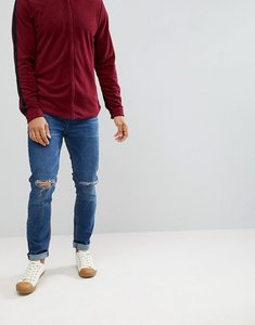 Read more about Asos skinny jeans in dark wash with knee rips - dark wash blue