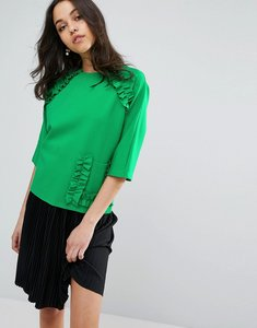 Read more about Lost ink short sleeve top with extreme frill and pocket - green