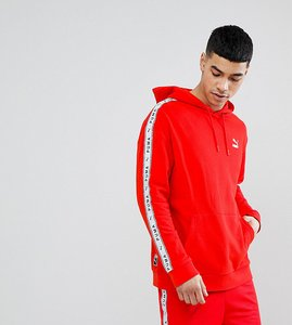 Read more about Puma pullover hoodie with taped side stripe in red exclusive to asos - red