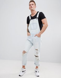Read more about Asos design skinny denim dungarees in light wash blue with heavy rips - light wash blue