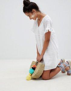 Read more about Asos design v front v back smock mini dress in broderie - white