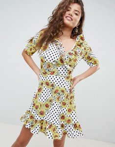 Read more about Asos design wrap mini skater dress in daisy spot print - multi