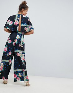Read more about Asos design jumpsuit with overlay and wide leg in floral print - multi