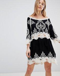 Read more about Liquorish lace and crochet beach dress - black cream