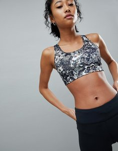 Read more about Nike training mid support swoosh bra in marble print - multi