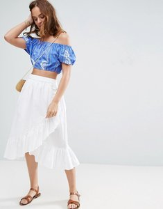 Read more about Asos wrap midi skirt in cotton with ruffle hem - white