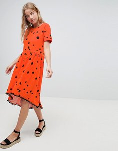 Read more about Asos design smock dress with hi lo pom pom hem in spot print - blurred spot