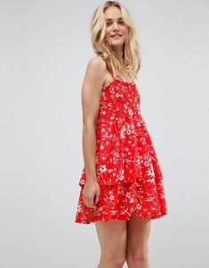 Read more about Asos shirred mini sundress with tiered skirt in red ditsy print - red ditsy