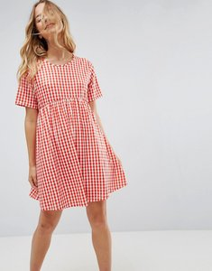 Read more about Asos ultimate mini smock dress in gingham - red white gingham