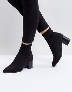 Read more about Asos ricky mid heeled sock boots - black