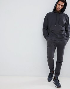 be0ce7da9a7e7 Read more about Asos design tracksuit oversized hoodie super skinny joggers  in washed black - bal