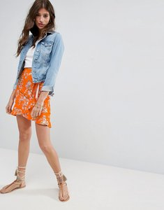Read more about Asos wrap mini skirt with tie waist in ditsy print - orange print