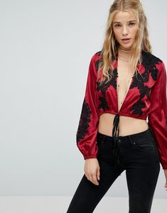 Read more about Kiss the sky long sleeve plunge embroidered crop top in satin with tie front - wine