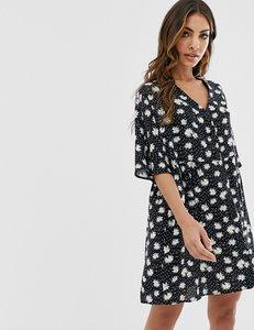 Read more about Asos design v neck button through mini smock dress in daisy spot print