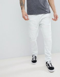 Read more about Asos design drop crotch jeans in bleach wash blue with extreme rips - light wash blue