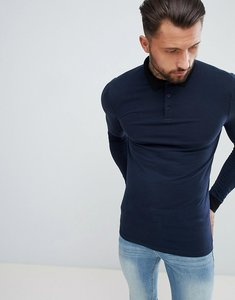 9b1f064c Read more about Asos design muscle fit long sleeve polo with contrast  collar in navy -