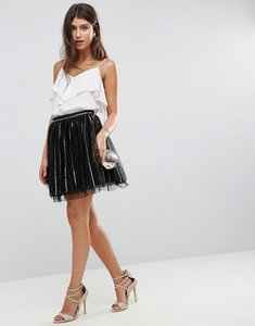 Read more about Asos sequin stripe tulle mini skirt with spot mesh underlayer - black