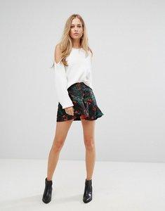 Read more about Vero moda floral ruffle mini skirt - black
