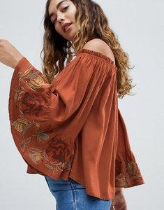 Read more about Hazel off shoulder lace cuff blouse - rust