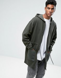 Read more about Asos oversized extreme longline jersey parka with woven pockets ring pulls raw edge - khaki