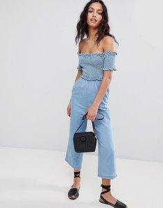 Read more about Asos design denim shirred bardot jumpsuit in lightwash blue - blue