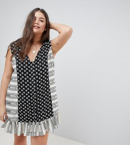 Read more about Asos design curve mini tab side button through pep hem sundress in mixed print - multi