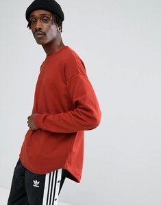 Read more about Asos oversized longline sweatshirt with curved hem in red - autumn