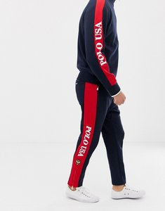 Read more about Polo ralph lauren zip hem joggers with logo side stripe in navy red