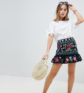 Read more about Asos design petite star embroidered mini skirt with pep hem - multi