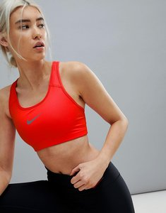 Read more about Nike training medium support swoosh bra in red - habanero red gunsmo