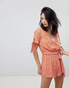 Read more about Honey punch playsuit with tie waist in tulip spot print - orange spot